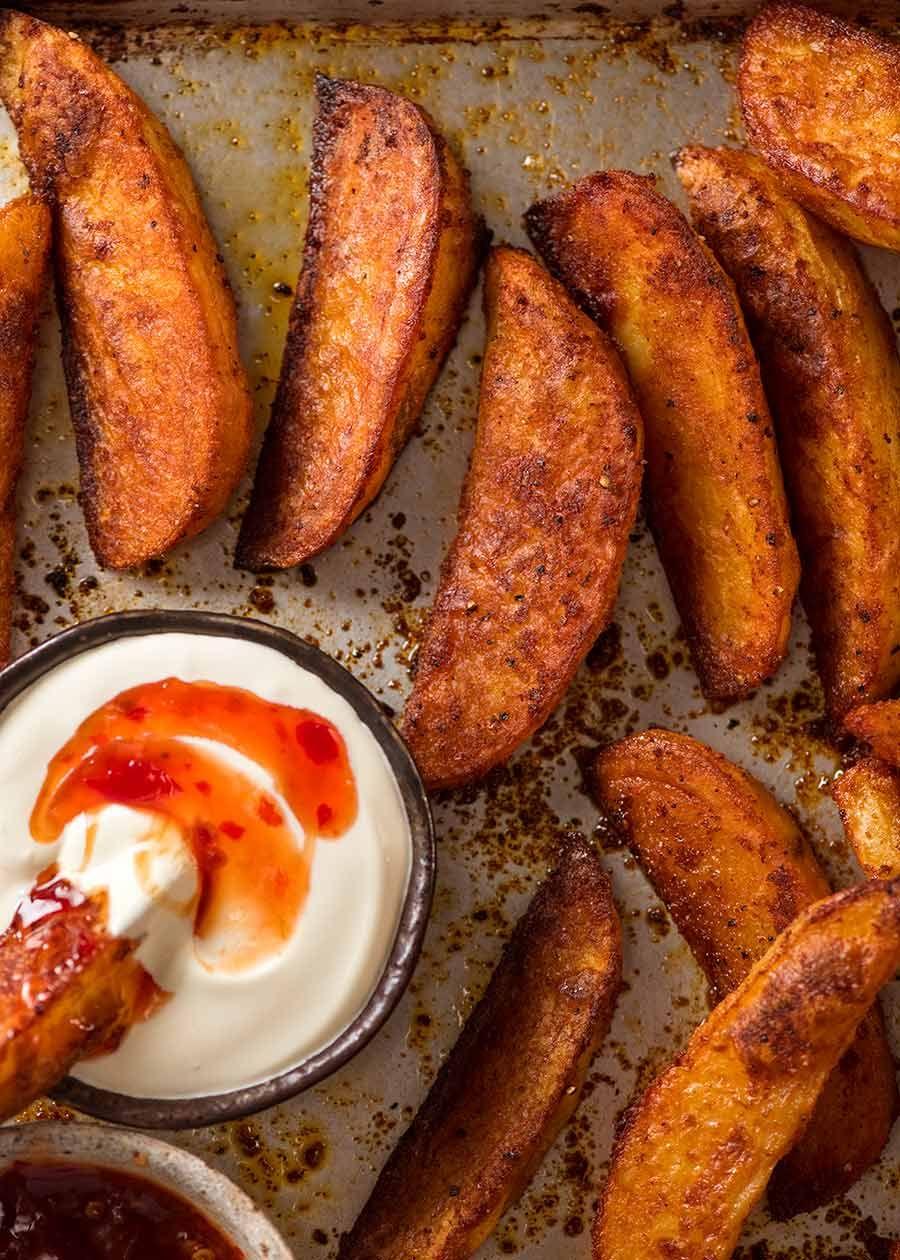Crunchy Seasoned Baked Potato Wedges Recipe Potato Wedges Baked Recipetin Eats Seasoned Potato Wedges