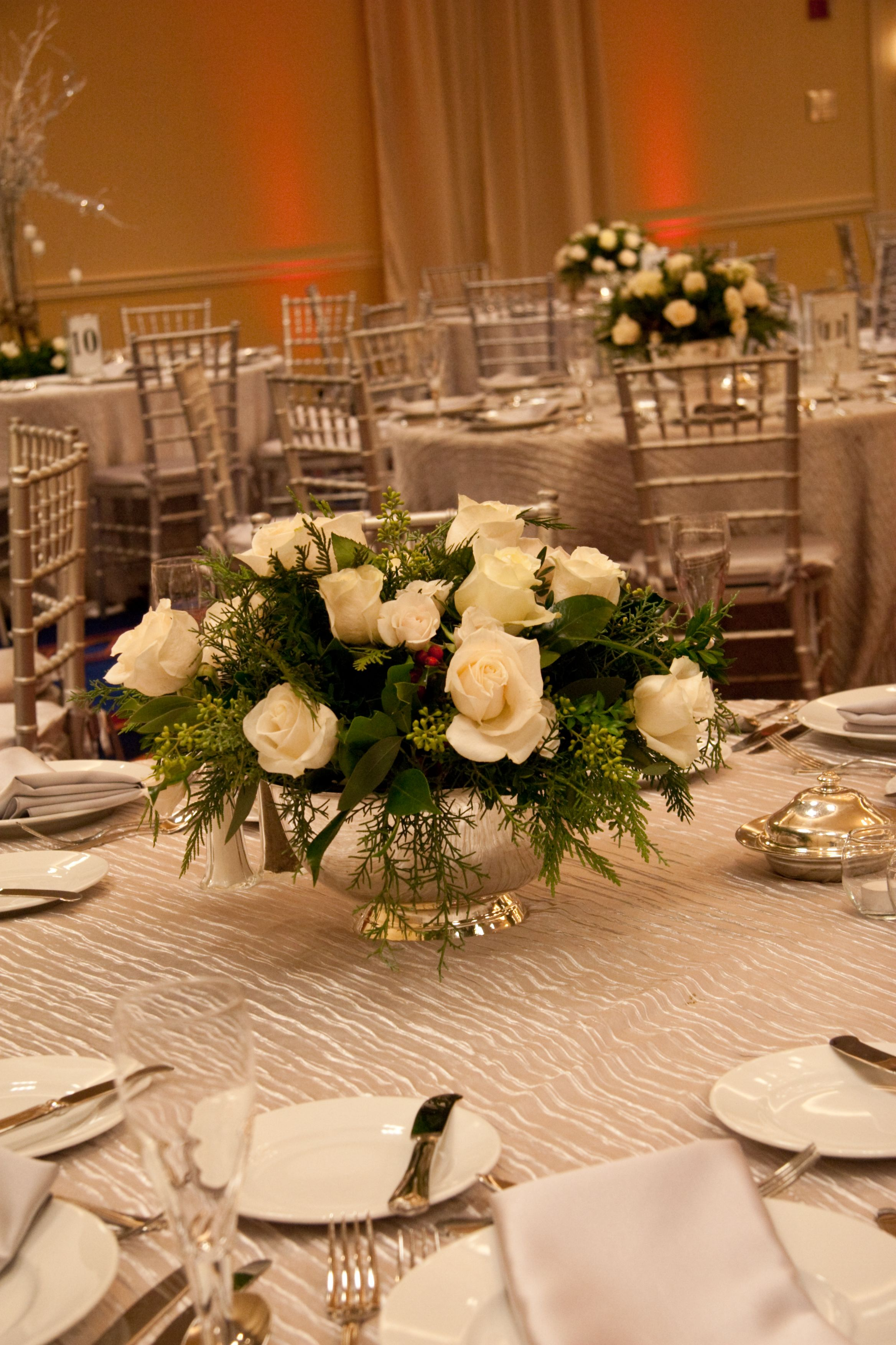 Low Winter Centerpieceswhite Roses, Winter Greens, Pine Cones In Silver