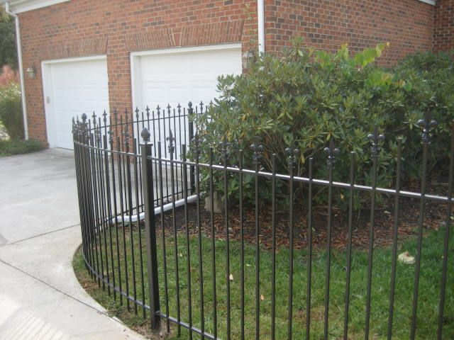 Custom Curved Iron Dog Fence With Fleur E Lis Finials And
