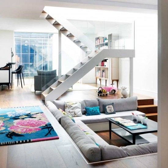 Open-plan living area with retro sunken seating Home Design