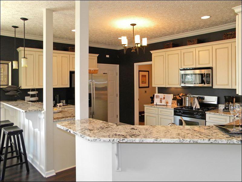 white kitchen cabinets dark countertops | The kitchen\'s ...