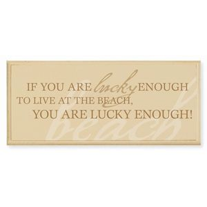 "Looking for a great addition for your house, or a gift that is guaranteed to be loved? Look no further than our weathered beach house signs and frames. This sign can be hung on the wall or displayed on a shelf using a provided standing peg. Made in the USA  from 100% recycled wood. ""If you are lucky enough to live at the beach, you are lucky enough!"""