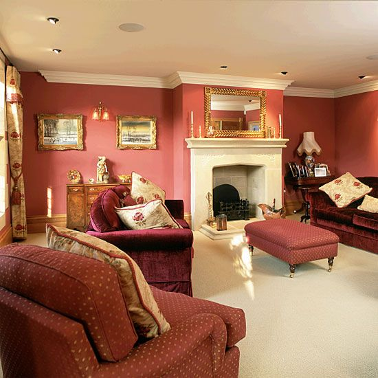 Living room with red walls and sofas is part of Large Living Room Colours - If you have a large living room, why not paint it a bold shade, such as this rich Rose colour from Morris & Co