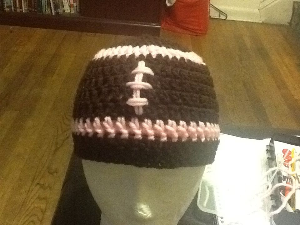 In pink football beanie