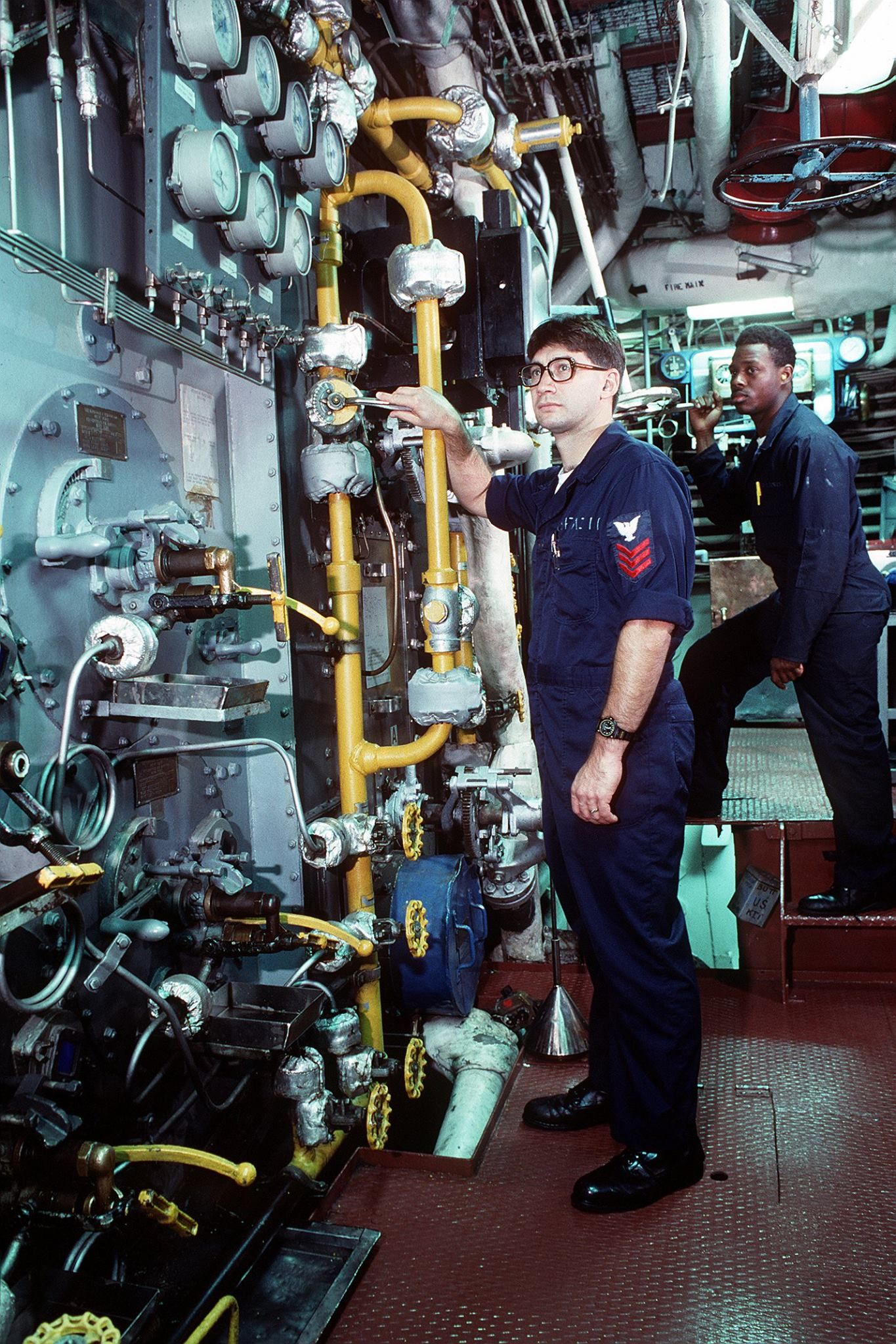 Queen Mary Engine Room: Boiler Technicians Monitor Gauges In The Boiler Room Of