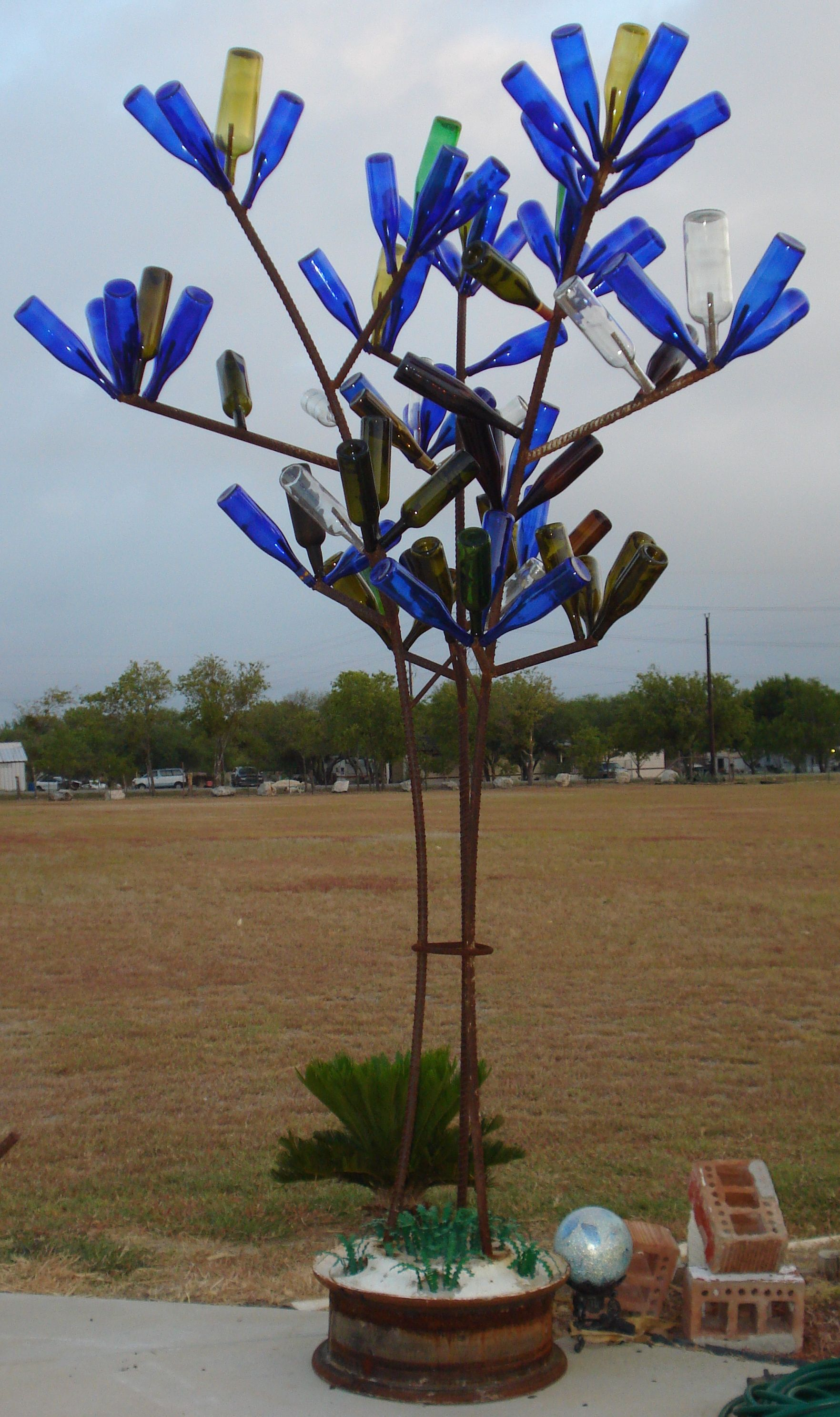 Bottle Tree Made Out Of Rebar And Old Semi Truck Wheel