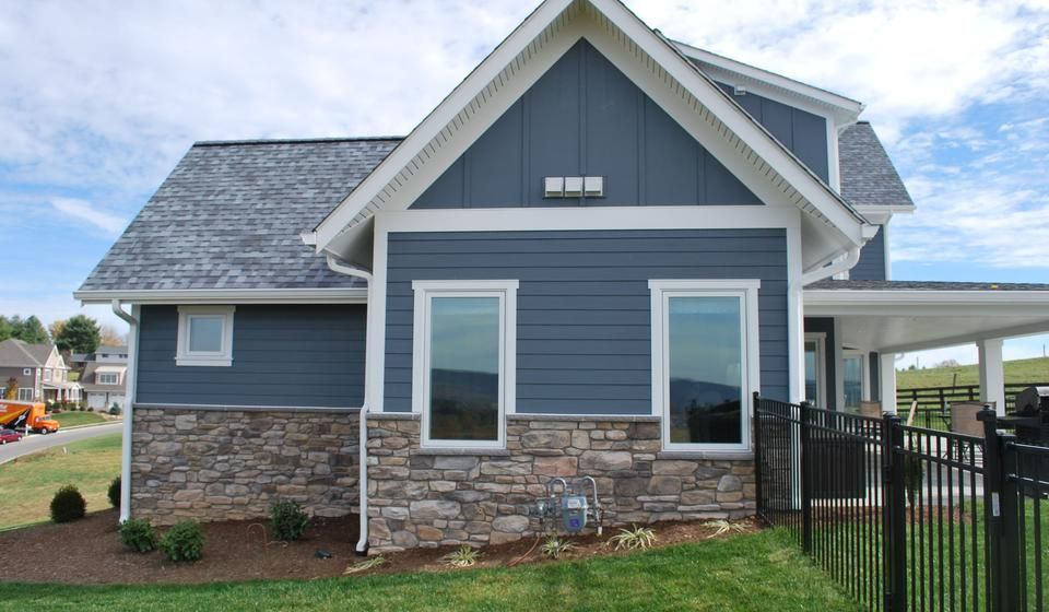 Contemporary farmhouse with stone accents white trimming dusty