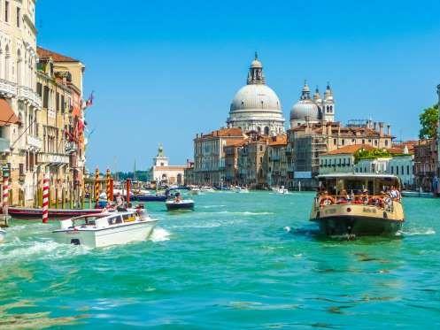 Canal Grande with Basilica di Santa Maria della Salute in Venice, Italy - bluejayphoto/Getty Images