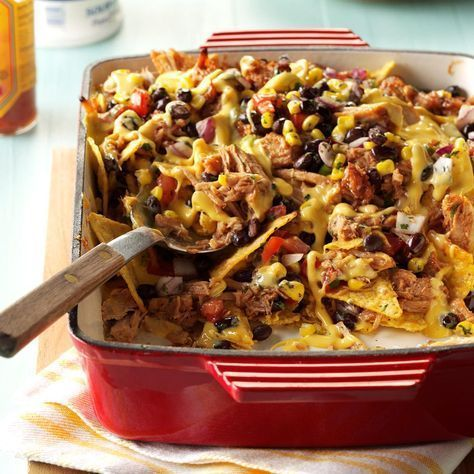 Southwestern Nachos Recipe -Guests will go crazy when you serve two heaping pans of this cheesy nacho casserole, with tender chunks of slow-cooked pork. You don't need to worry about filling the chip bowl—the tortilla chips are conveniently baked right in the dish!— Kelly Byler, Goshen, IndianaSouthwestern Nachos Re...
