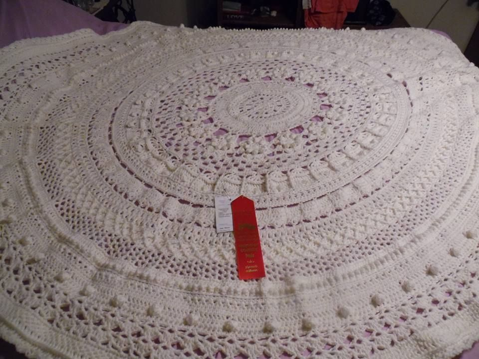 The Queen Mandala won second prize on a county fair.  It is crocheted by Amy Marie Morse.  the Queen Mandala Throw pattern can be purchased on the website http://mandalaqueen.org