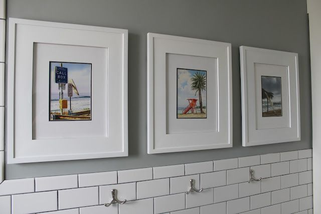 Bathroom cabinets disguised as picture frames! Love it!