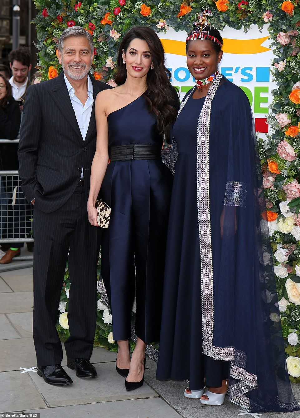 George Clooney poses with stunning wife Amal at event in