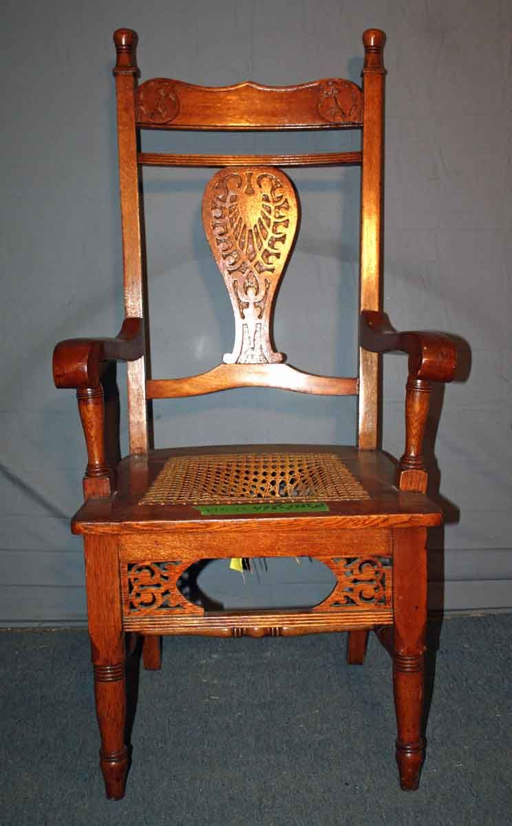 Carved victorian oak chair with caned seat oak chair