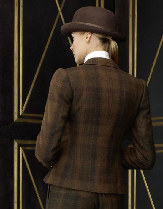 The tailoring of this elegant menswear-inspired jacket, crafted out of luxurious cashmere plaid, harkens back to early 20th century England.  Ralph Lauren Collection.