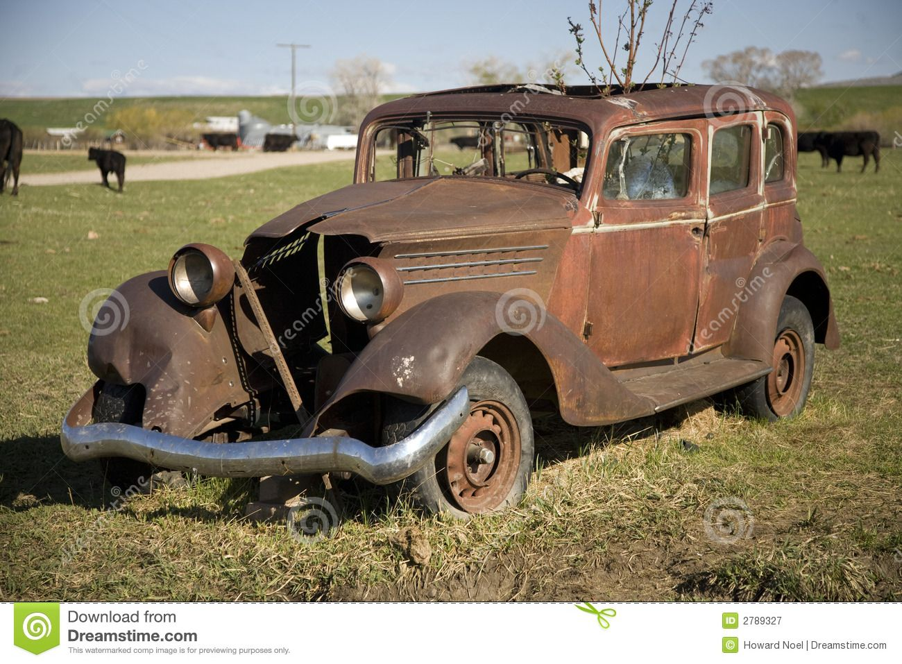 Photo about This is an old, rusty car -- long since retired and ...