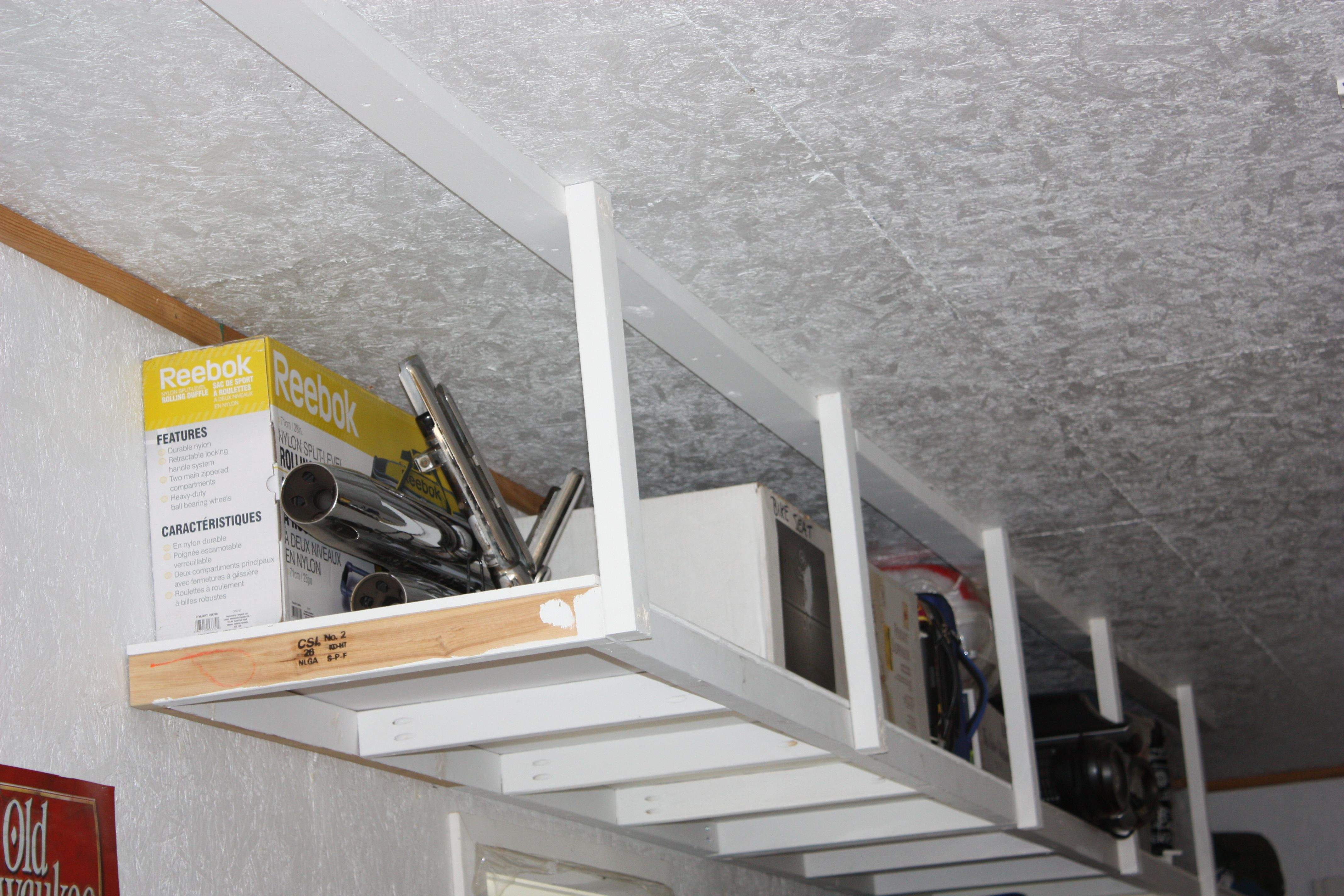 ceiling for garage spaces small lowes canada storage wall mounted cabinets with plastic metal shelves ceilings