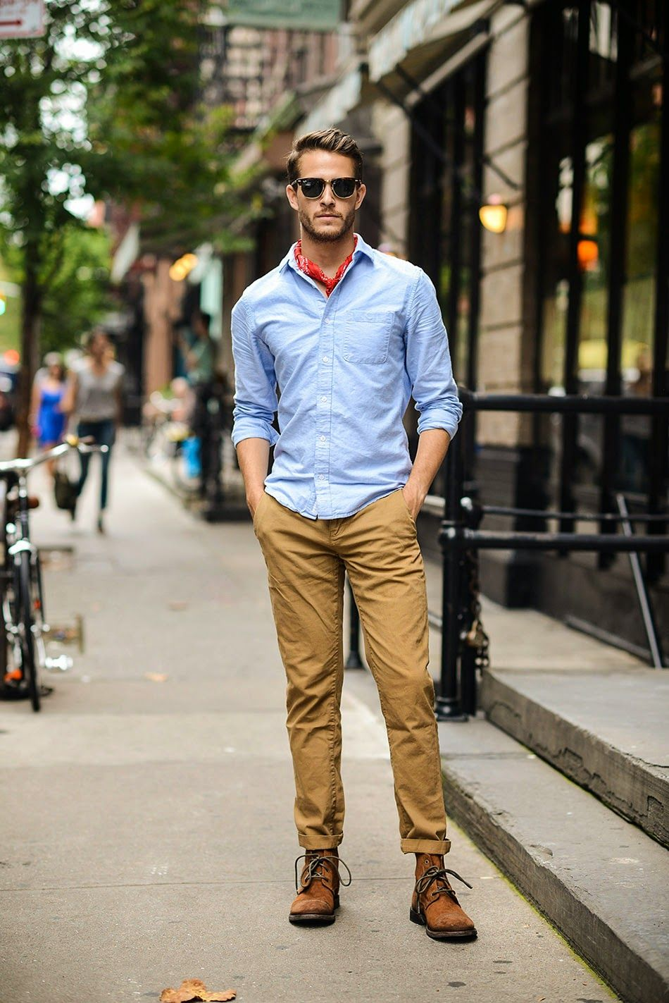with tan chinos brown chukka boots blue oxford shirt with rolled up sleeves  J Crew sunglasses red bandana in this transition look 212d1acbb6
