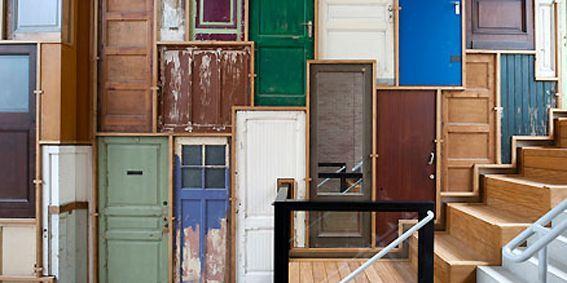 hallway decorated with doors (piet hein eek)