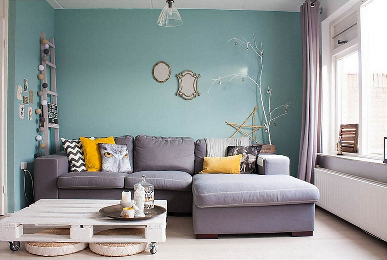 Lovely living room interior desig with blue wall paint for C shaped living room