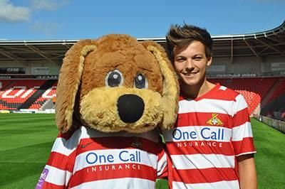 "Tomlinson Ryan Trust posted this on Facebook! ""Louis and Doncaster Rovers Mascot Donny"""