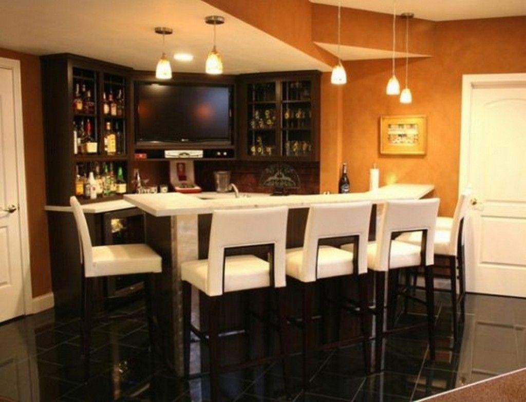 Modern Luxury Home Bar With Pristine White Leather Bar Stools Dark Wood  Legs And White Laminate