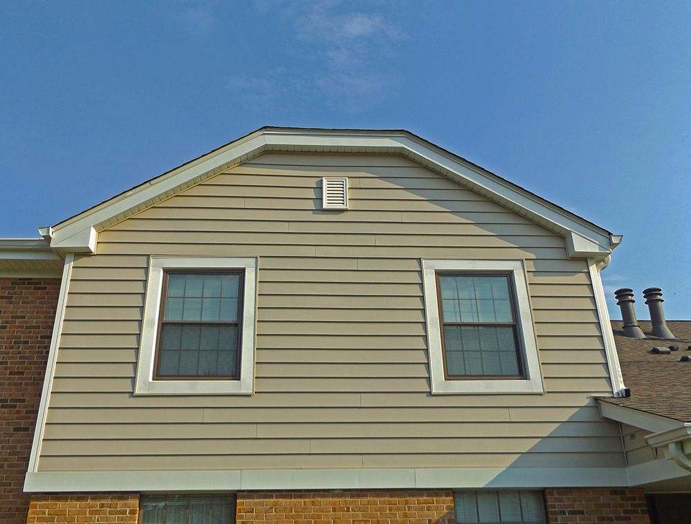 We replaced old and deteriorating siding with beautiful