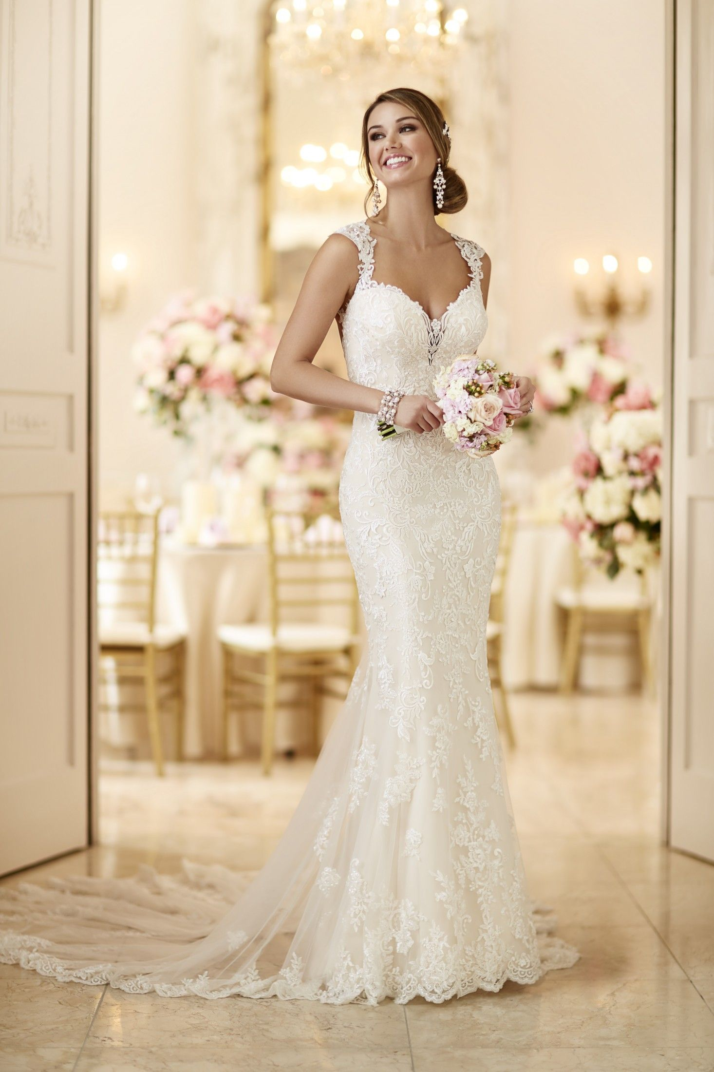 This romantic lace over matteside lustre satin wedding gown from