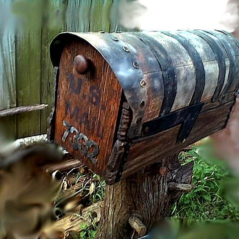 A Custom Handmade Mailbox Built From Wood And Iron And Mounted On A