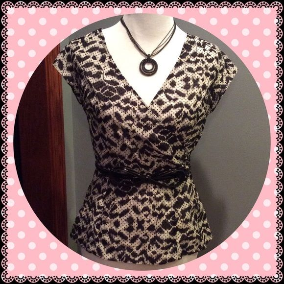 Gorgeous Black & White Top The Limited top with zipper on the side. Has belt loops, but belt is not included. 28% silk. Very flattering fit. Only worn once, like new condition. No trades. The Limited Tops Blouses