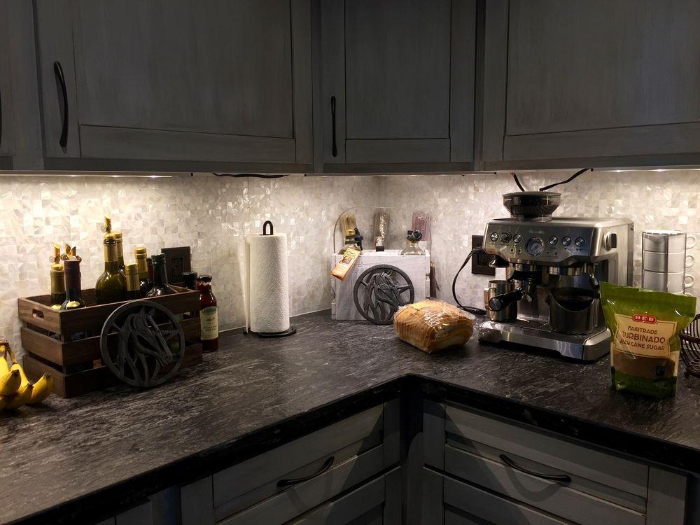 Large white groutless pearl shell tile gourmet kitchen backsplash ...