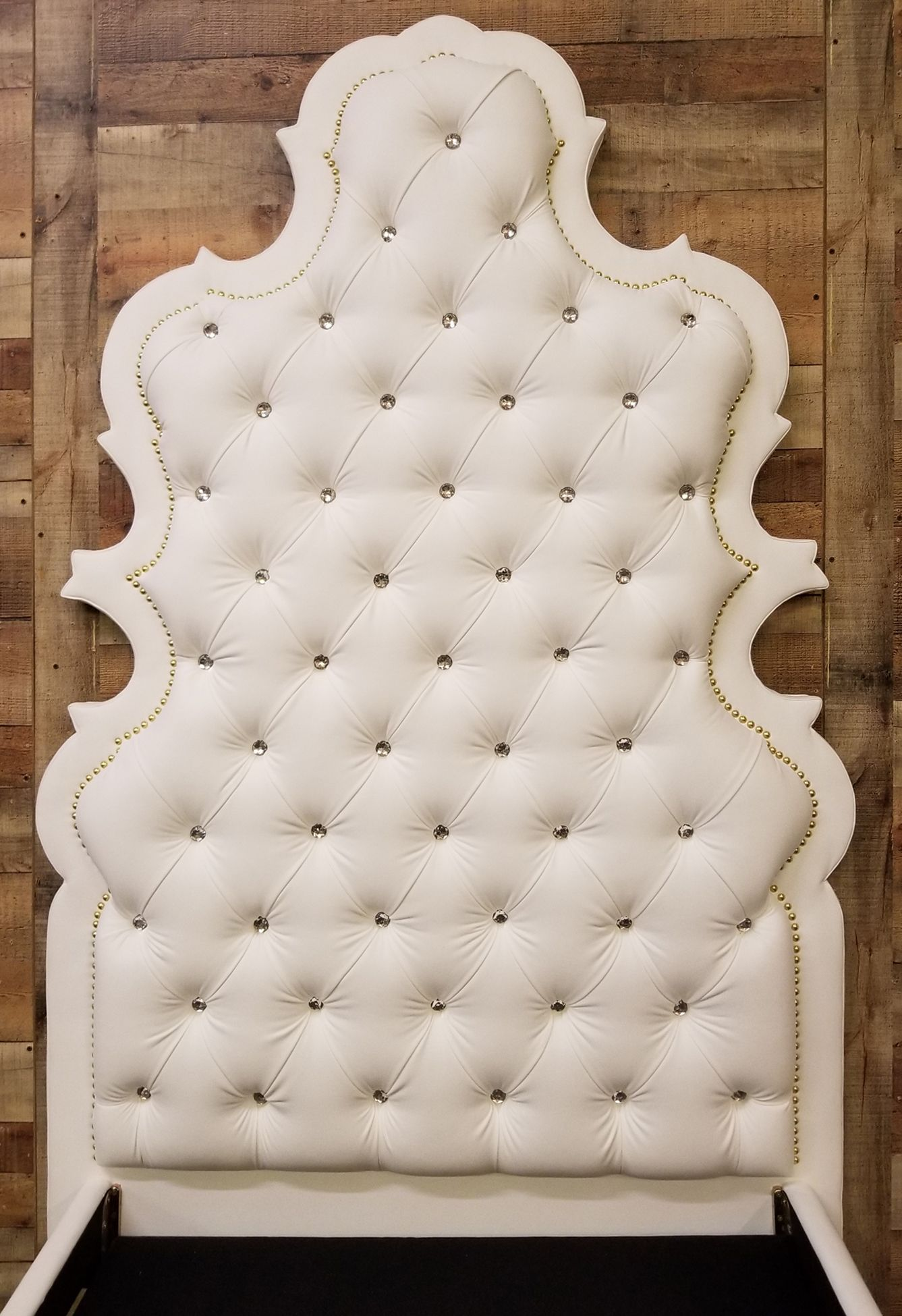 Upholstered In A White Faux Leather Deep Button Tufted Headboard