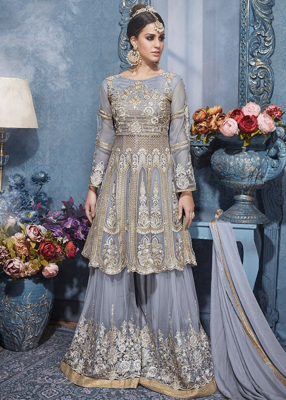 a67cc9e3ba Look #beautiful by wearing this light #grey #net #sharara style #suit  richly crafted with #resham, #zari ,stone and patch work.
