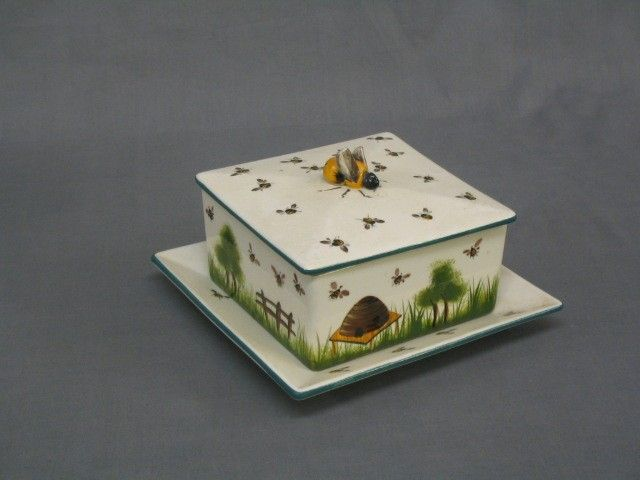 A Wemyss Griselda Hill Pottery Square Honey Pot And Cover Raised On Separate Stand Decorated Bees The Finial In Form Of Bee Wing F R
