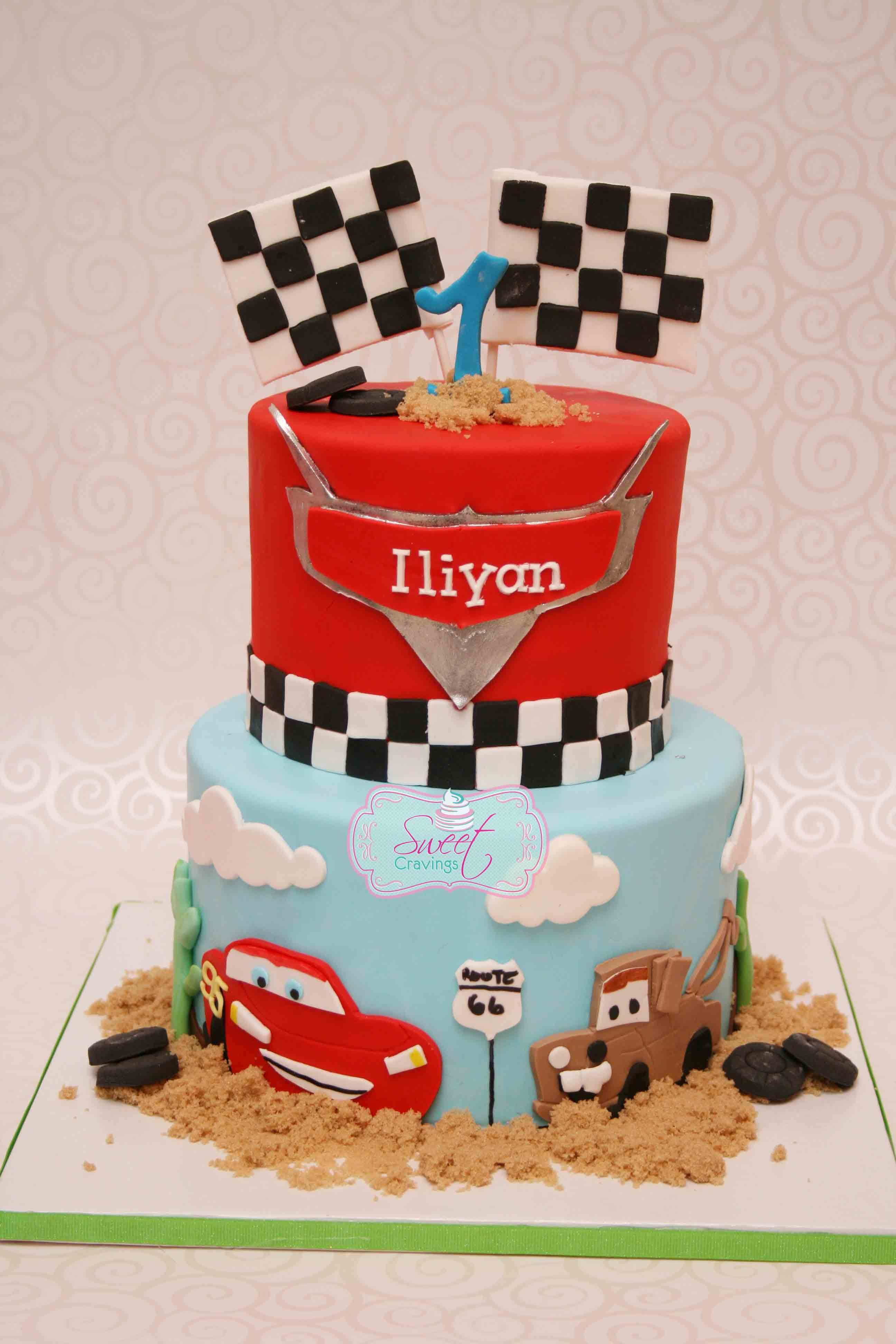 Cars themed first birthday cake Hand cut lightening McQueen and