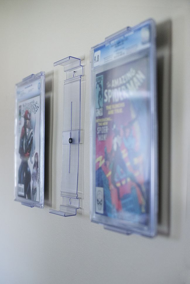 the new comicmount comic book display here is an image showing how the comic books are mounted. Black Bedroom Furniture Sets. Home Design Ideas