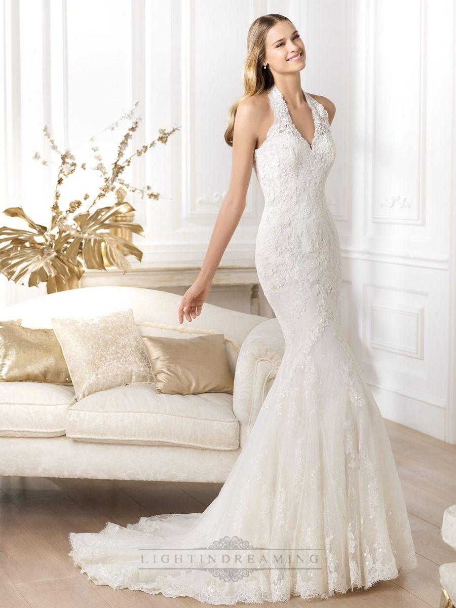 Exquisite halter neck mermaid wedding dress featuring applique