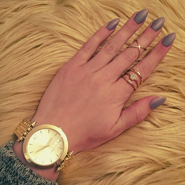 Almond shaped acrylic nails with a Matte Grey polish. Accessorize with some cute rings and a watch!