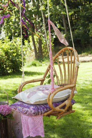 I Love This!!!....cut the legs off a cane chair...... add rope and you have an outdoor hanging chair.