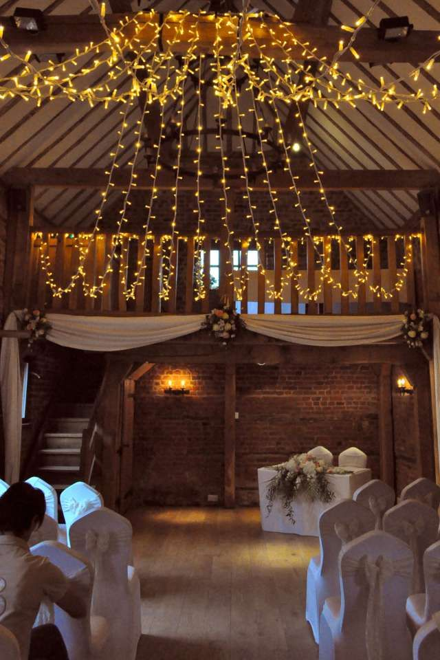A Gathered Fairy Light Canopy In The Charming And Intimate Stables