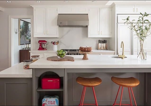 This clean sleek kitchen is given a touch of red to add a