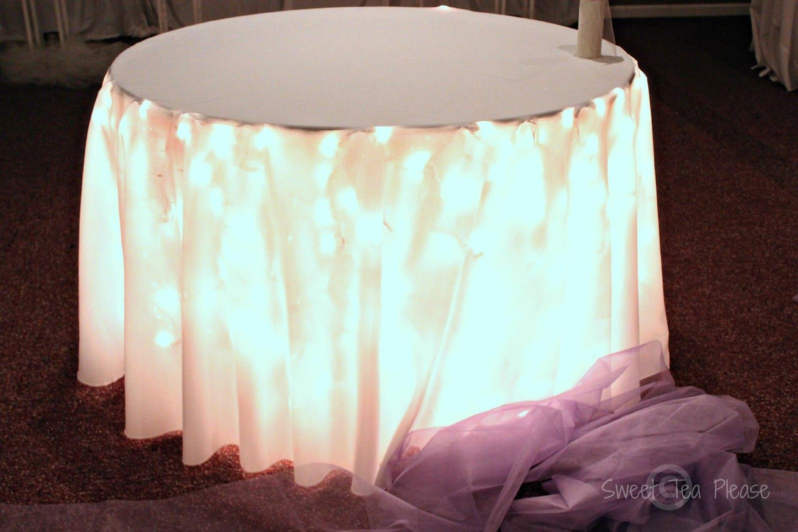 Goddess of Eats Decorating a Cake Table With Lights and