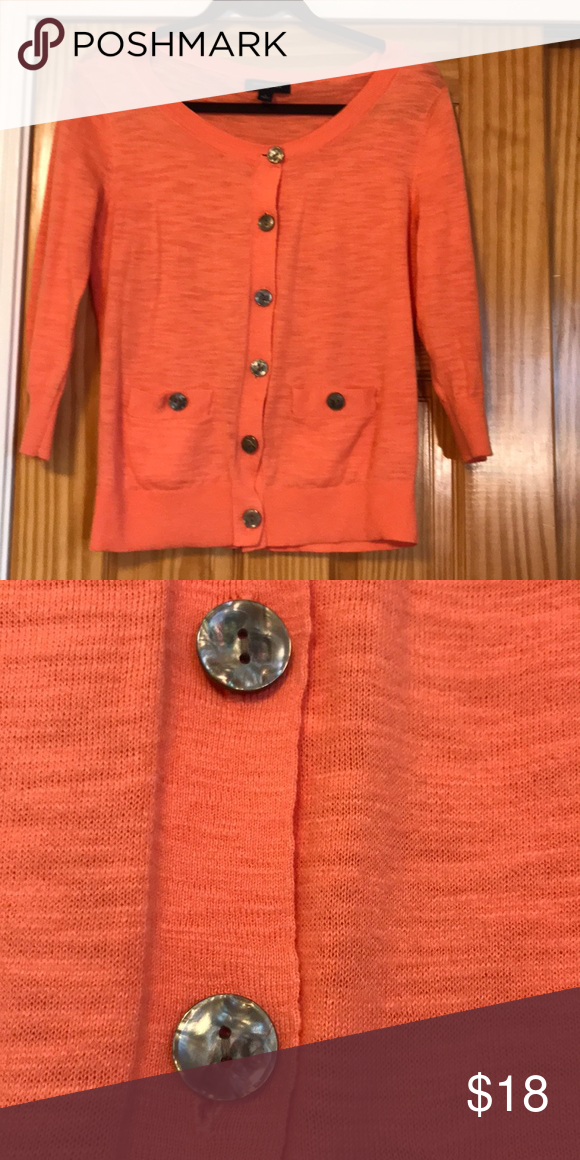 45e38ffc1d Coral button down cardigan Beautiful 3 4 sleeve button down coral cardigan  Mother of pearl-like buttons Cute little front pockets Great condition-  small ...