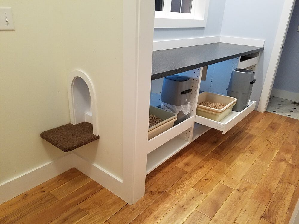 Spoiled kitty comfort station hidden in mudroom space for Ikea litter box