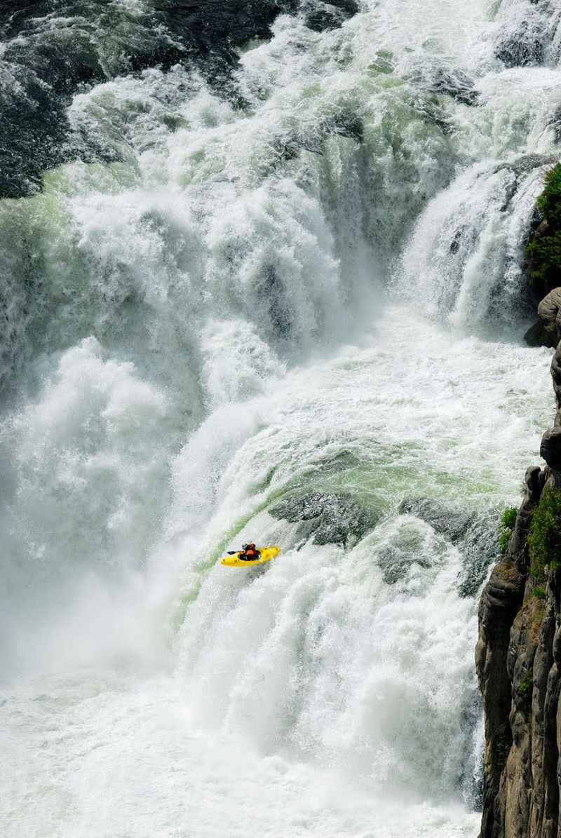 Kayaker plunges over the 65 foot tall Lower Mesa Falls near Ashton, Idaho
