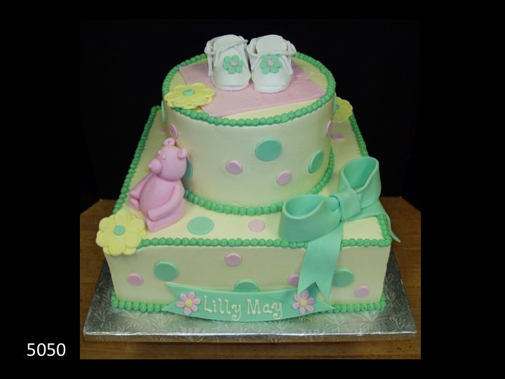 green, pink, and yellow baby shower cake with booties on top, Baby shower invitation