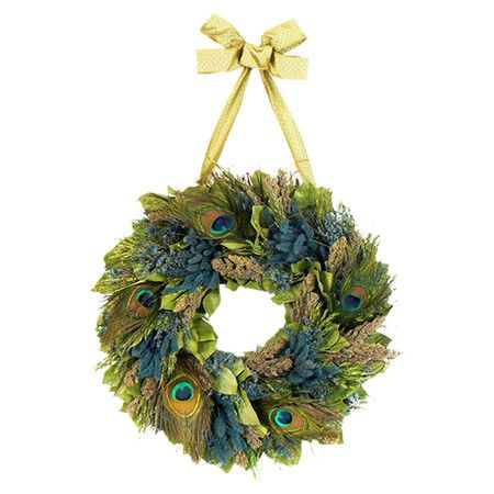 Wreath with assorted preserved leaves and peacock feather accents.  Product: WreathConstruction Material: Natura...