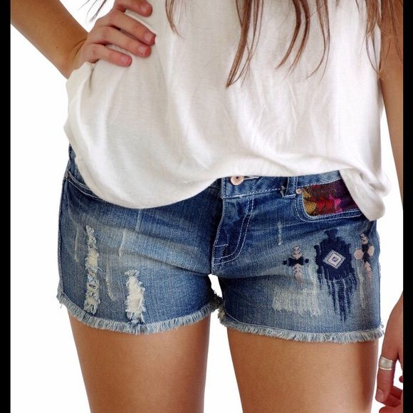 Aztec Denim Cutoffs Super cute denim shorts distressed with holes and detailed with aztec embroidery and cutoff hem. 2 Larges available. Approx. 30 inch waist. Shorts Jean Shorts