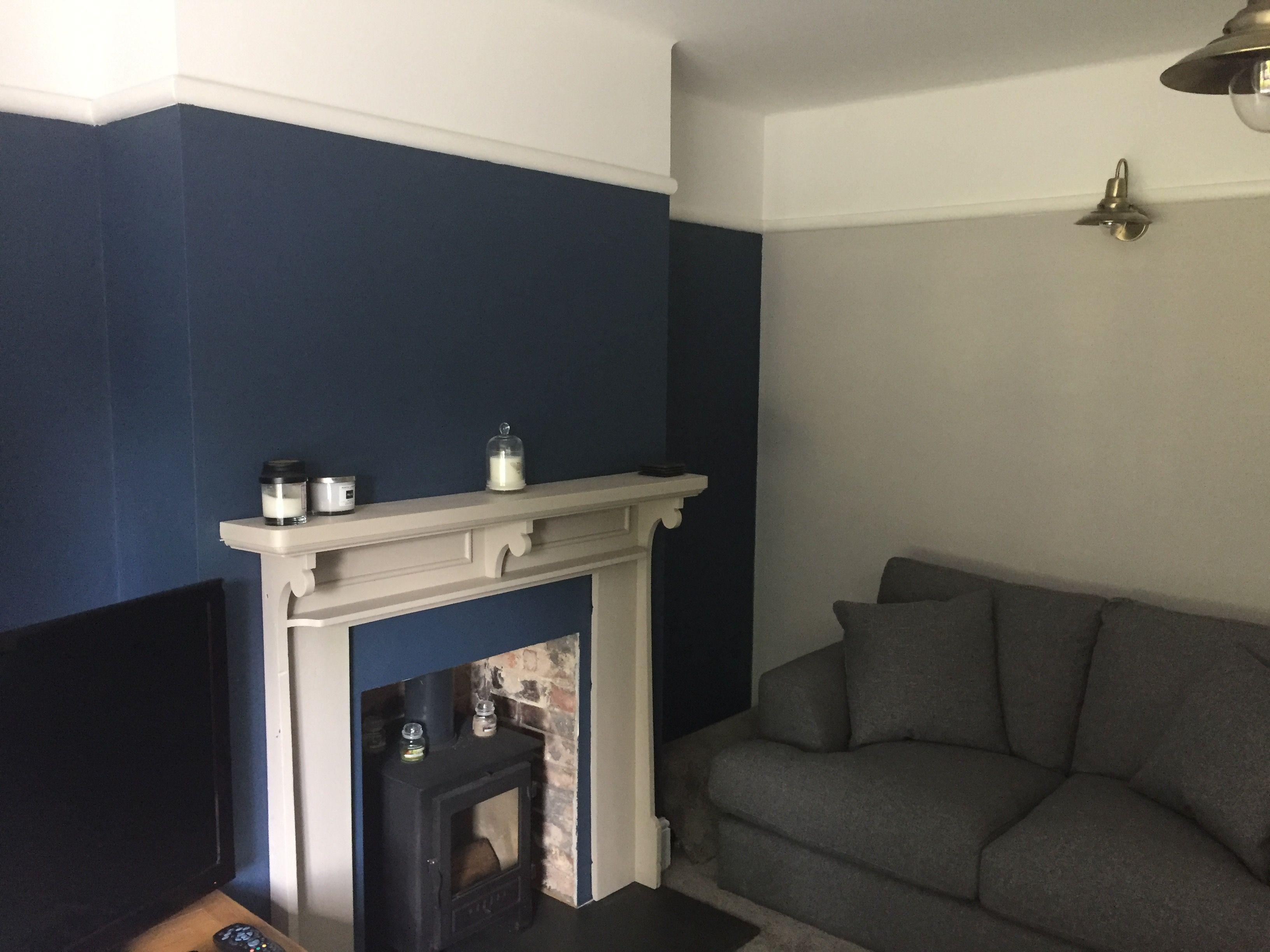 Farrow & Ball stiffkey blue and cornforth white lounge.