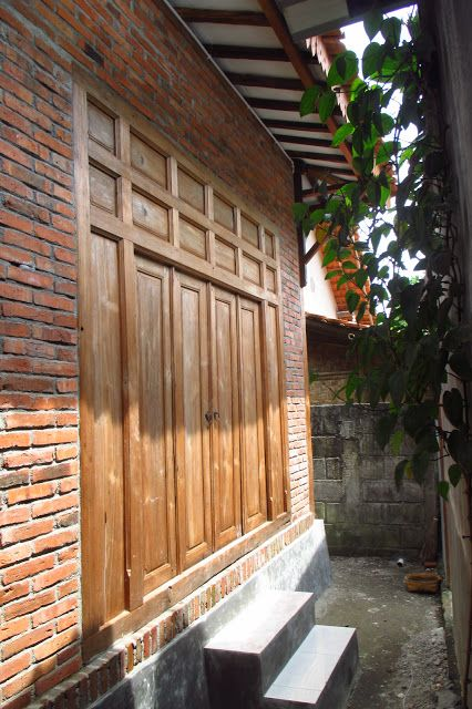 Image result for a combination of brick walls and teak doors