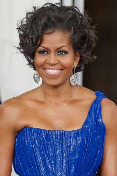 Intelligent Attorney & First Lady, Michelle Obama, looking elegant in a  glittery blue dress